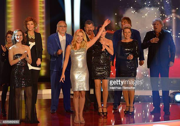 Stefanie Hertel center performs during the rehearsal of the tv show 'Stefanie Hertel Meine Stars' on September 23 2014 in Zwickau Germany