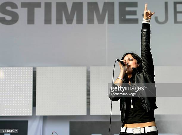 Stefanie Kloss from Silbermond performs on stage during the 'Music And Messages' concert on June 7 2007 in Rostock Germany Musicians Bono Sir Bob...