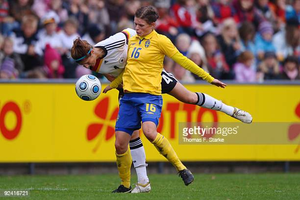 Stefanie Mirlach BACK of Germany and Susanne Moberg of Sweden tackle for the ball during the women's international friendly match between Germany U20...