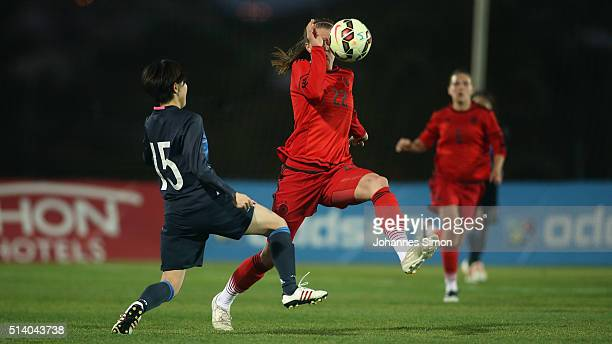 Stefanie Sanders of Germany and Mayu Sasaki of Japan fight for the ball during the women's U23 international friendly match between WU20 Germany and...