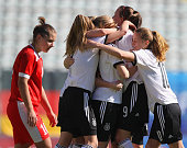 Stefanie Sanders of Germany with her teammates celebrate after scoring the opening goal during the UEFA Under17 women's Elite Round match between U17...