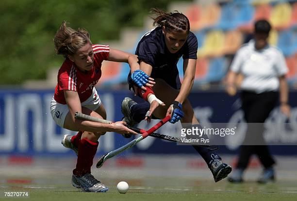 Stefanie Schneider of RW Koeln battles for the ball with Vera Battenberg of Ruesselheimer RK during the womens German Field Hockey Championship final...