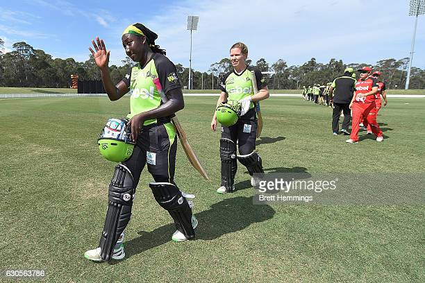 Stefanie Taylor of the Thunder and Alex Blackwell of the Thunder leave the field after victory during the WBBL match between the Thunder and...