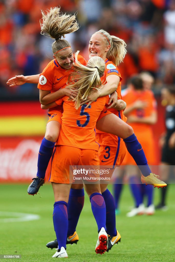 Stefanie van der Gragt, Kika van Es and Jackie Groenen The Netherlands team celebrate at the final whistle after victory during their Group A match between Netherlands and Norway during the UEFA Women's Euro 2017 at Stadion Galgenwaard on July 16, 2017 in Utrecht, Netherlands.