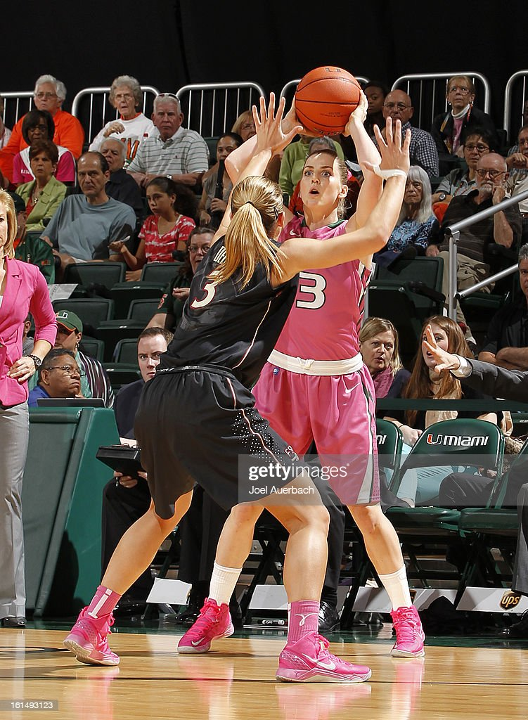 Stefanie Yderstrom #3 of the Miami Hurricanes attempts to pass the ball past Alexa Deluzio #3 of the Florida State Seminoles on February 10, 2013 at the BankUnited Center in Coral Gables, Florida. The Seminoles defeated the Hurricanes 93-78.