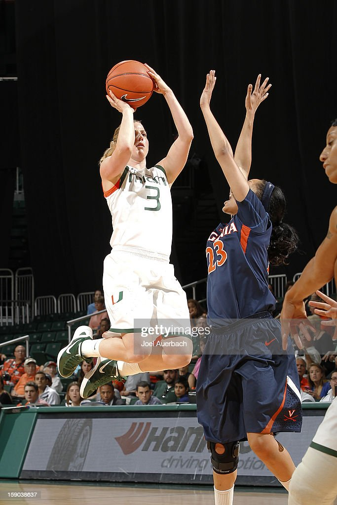 Stefanie Yderstrom #3 of the Miami Hurricanes shoots the ball past Ataira Franklin #23 of the Virginia Cavaliers on January 6, 2013 at the BankUnited Center in Coral Gables, Florida.