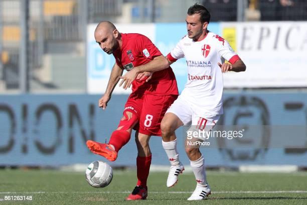 Stefano Amadio of Teramo Calcio 1913 compete for the ball with Roberto Candido of Padova Calcio during the Lega Pro 17/18 group B match between...