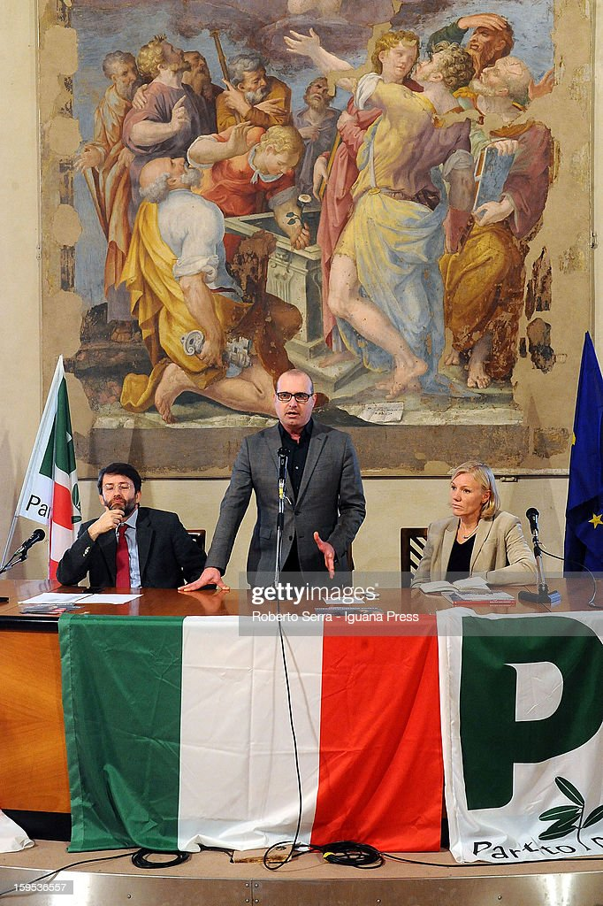 Stefano Bonaccini (C), regional secretary of PD Democratic Party, presents Dario Franceschini (L) and Josefa Idem (R) as candidates for the Italian Parliament in the next political elections during a press conference on January 15, 2013 in Bologna, Italy. The elections of a new Italian Parliament will take place on February 24.