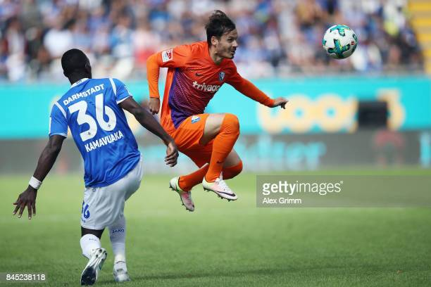 Stefano Celozzi of Bochum is challenged by Wilson Kamavuaka of Darmstadt during the Second Bundesliga match between SV Darmstadt 98 and VfL Bochum...