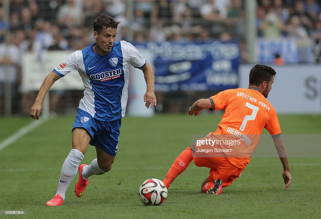 Stefano Celozzi of Bochum tackles Niko Giesselmann of Fuerth during the Second Bundesliga match between VfL Bochum and SpVg Greuther Fuerth at...