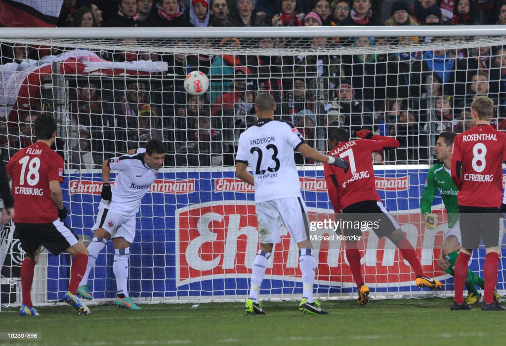 Stefano Celozzi (2. from l) of Frankfurt heads the ball off the line during the Bundesliga match between SC Freiburg and Eintracht Frankfurt at MAGE SOLAR Stadium on February 22, 2013 in Freiburg, Germany.