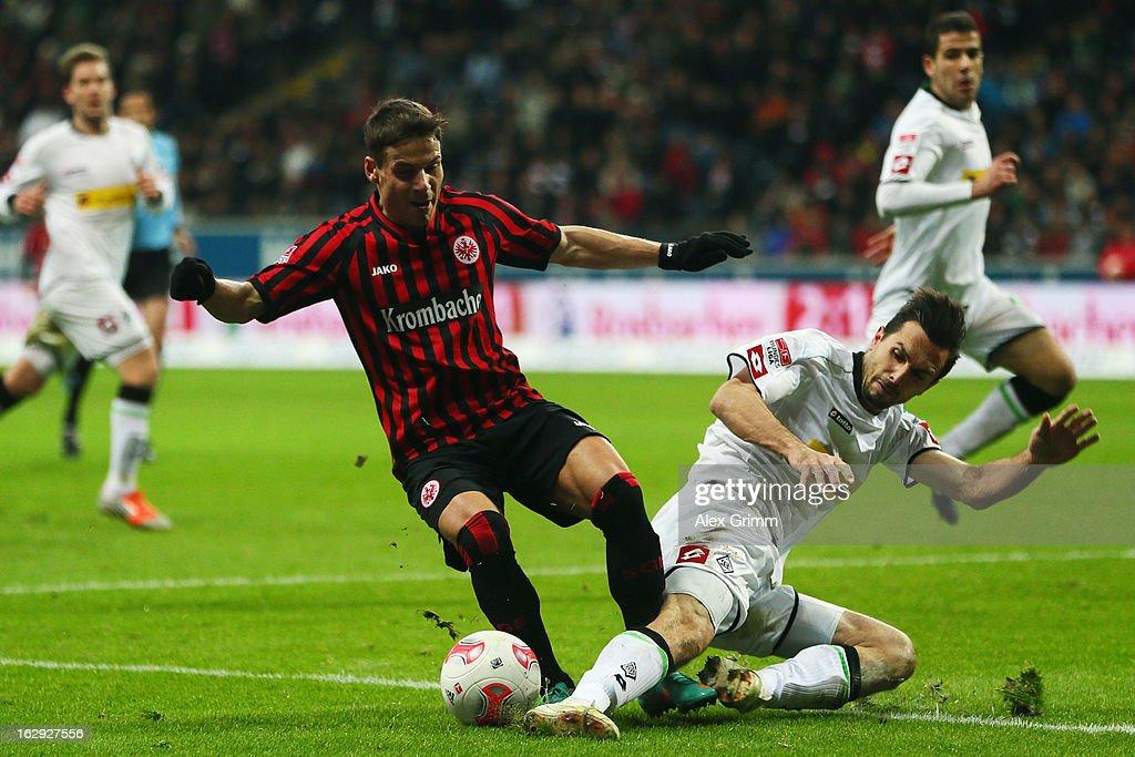 Stefano Celozzi of Frankfurt is challenged by Martin Stranzl of Moenchengladbach during the Bundesliga match between Eintracht Frankfurt and Borussia...