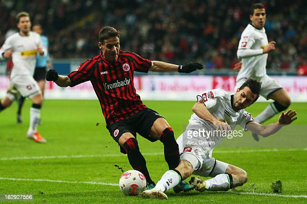 Stefano Celozzi of Frankfurt is challenged by Martin Stranzl of Moenchengladbach during the Bundesliga match between Eintracht Frankfurt and Borussia...