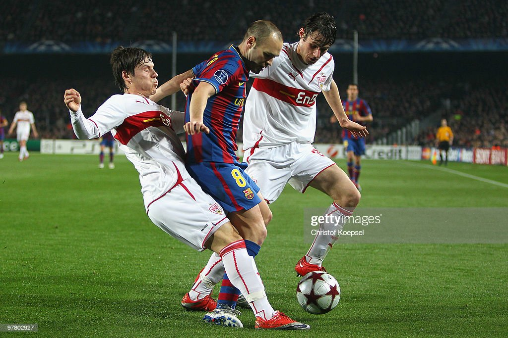 Stefano Celozzi of Stuttgart and Christian Traesch of Stuttgart challenges Andrés Iniesta of Barcelona during the UEFA Champions League round of...