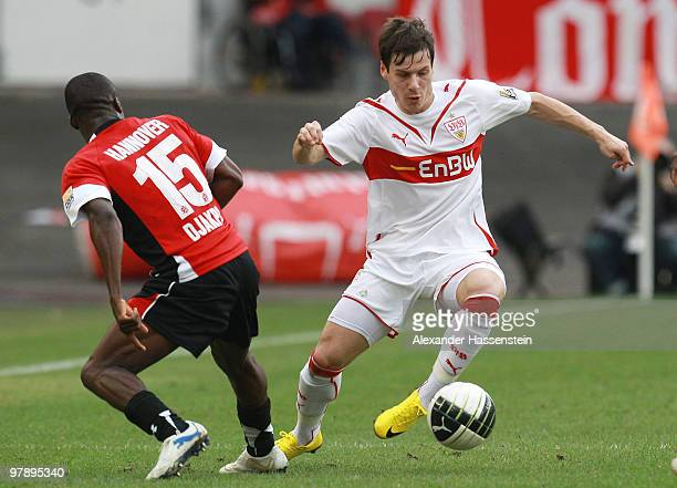 Stefano Celozzi of Stuttgart battles for the ball with Constant Djakpa of Hannover during the Bundesliga match between VfB Stuttgart and Hannover 96...