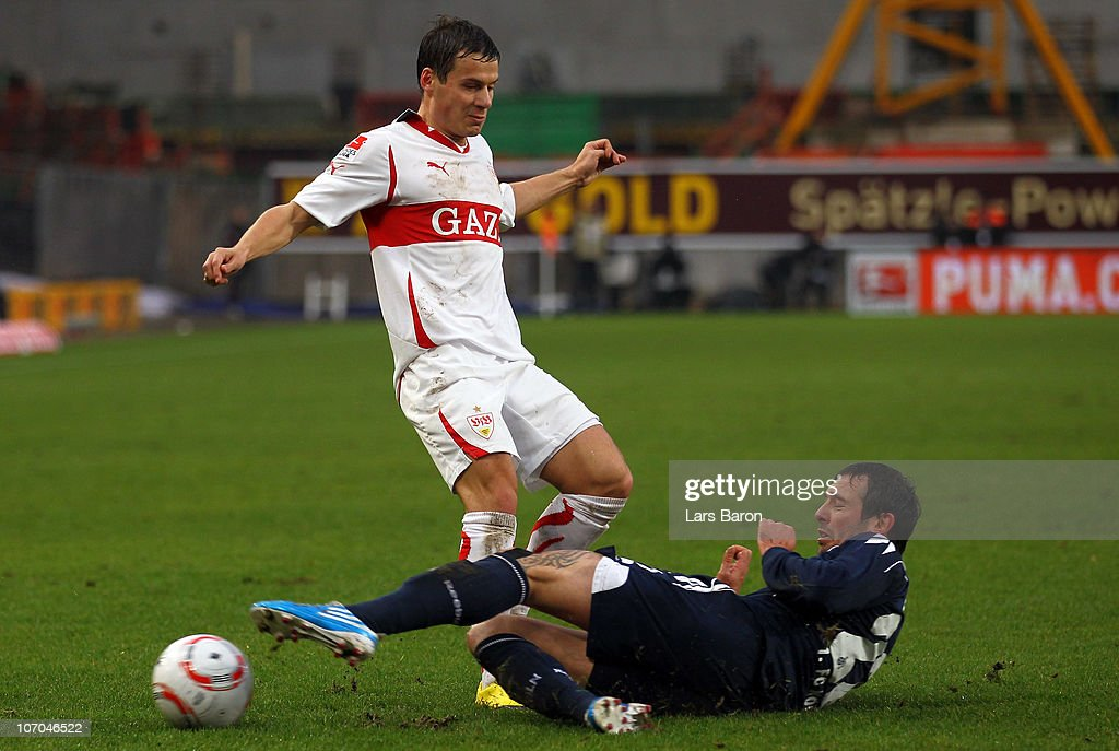 Stefano Celozzi of Stuttgart is challenged by Fabrice Ehret of Koeln during the Bundesliga match between VfB Stuttgart and 1 FC Koeln at MercedesBenz...