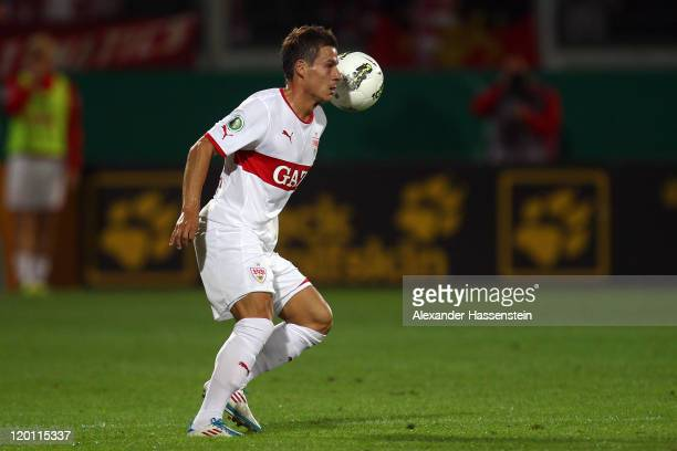 Stefano Celozzi of Stuttgart runs with the ball during the DFB Pokal first round match between SV WehenWiesbaden and VfB Stuttgart at Brita Arena on...