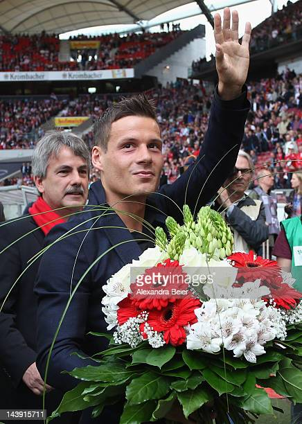 Stefano Celozzi of Stuttgart waves to fans as VfB president Gerd Maeuser stands behind him before the Bundesliga match between VfB Stuttgart and VfL...