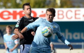 Stefano Cincotta of Burghausen and Anton Fink of Chemnitz compete for the ball during the Third League match between Wacker Burghausen and Chemnitzer...