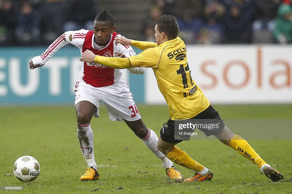 Stefano Denswil of Ajax (L), Bryan Linssen of VVV-Venlo (R) during the Dutch Eredivisie match between VVV-Venlo and Ajax Amsterdam at stadium De Koel on february 3, 2013 in Venlo, The Netherlands