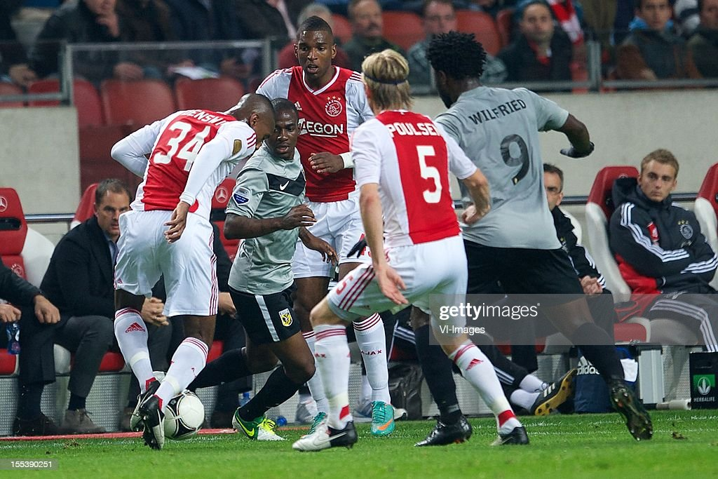 Stefano Denswil of Ajax, Gael Kakuta of Vitesse, Ryan Babel of Ajax during the Dutch Eredivisie match between Ajax Amsterdam and Vitesse Arnhem at the Amsterdam Arena on November 3, 2012 in Amsterdam, The Netherlands.