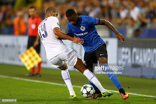 Stefano Denswil of Club Brugge takes on Islam Slimani of Leicester City during the UEFA Champions League match between Club Brugge KV and Leicester...