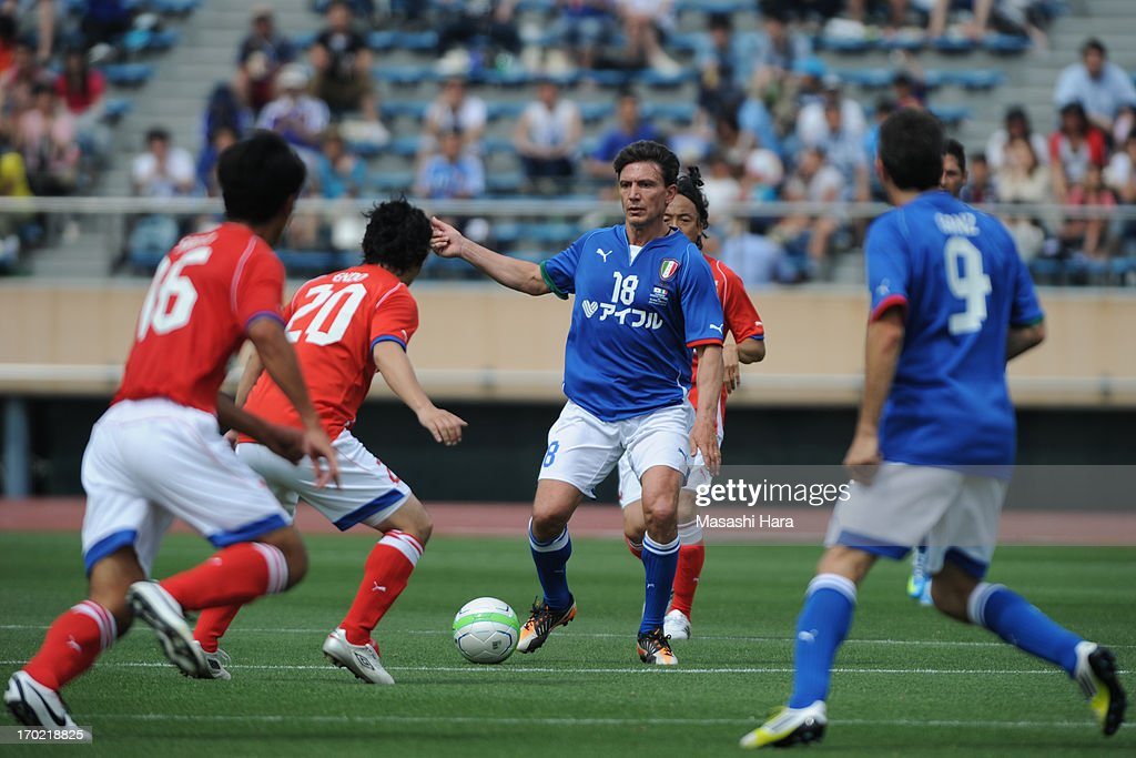 Stefano Eranio #18 in action during the J.League Legend and Glorie Azzurre match at the National Stadium on June 9, 2013 in Tokyo, Japan.