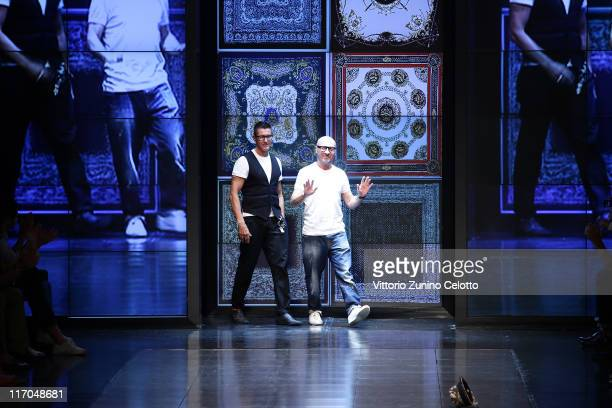 Stefano Gabbana and Domenico Dolce aknowledge the applause of the public after the DG fashion show as part of Milan Fashion Week Menswear...