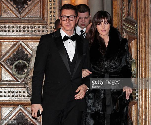 Stefano Gabbana and Italian actress Monica Bellucci leave the Italian Embassy in Moscow after 'Martini Gold by DolceGabbana' private cocktail and...