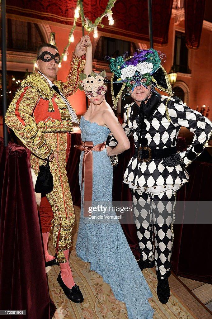 Stefano Gabbana, Rose McGowan and Domenico Dolce attends the 'Ballo in Maschera' to Celebrate Dolce&Gabbana Alta Moda at Palazzo Pisani Moretta on July 6, 2013 in Venice, Italy.