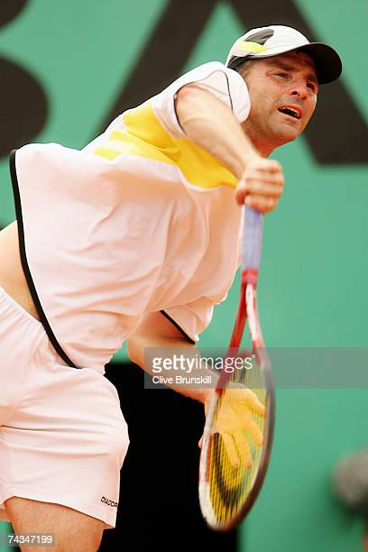Stefano Galvani of Italy serves to Nikolay Davydenko of Russia during the Men's Singles 1st Round match on day two of the French Open at Roland...