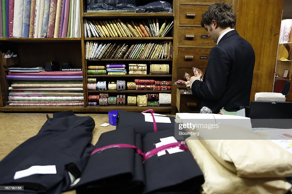 Stefano Gammarelli, an ecclesiastical tailor at Gammarelli, arranges clerical clothing inside his family's store in Rome, Italy, on Friday, Feb. 22, 2013. Gammarelli was founded in 1797 under Pope Pius VI as tailors to the clergy, and lists other papal customers as John Paul I, Paul VI, and John XXIII. Photographer: Alessia Pierdomenico/Bloomberg via Getty Images