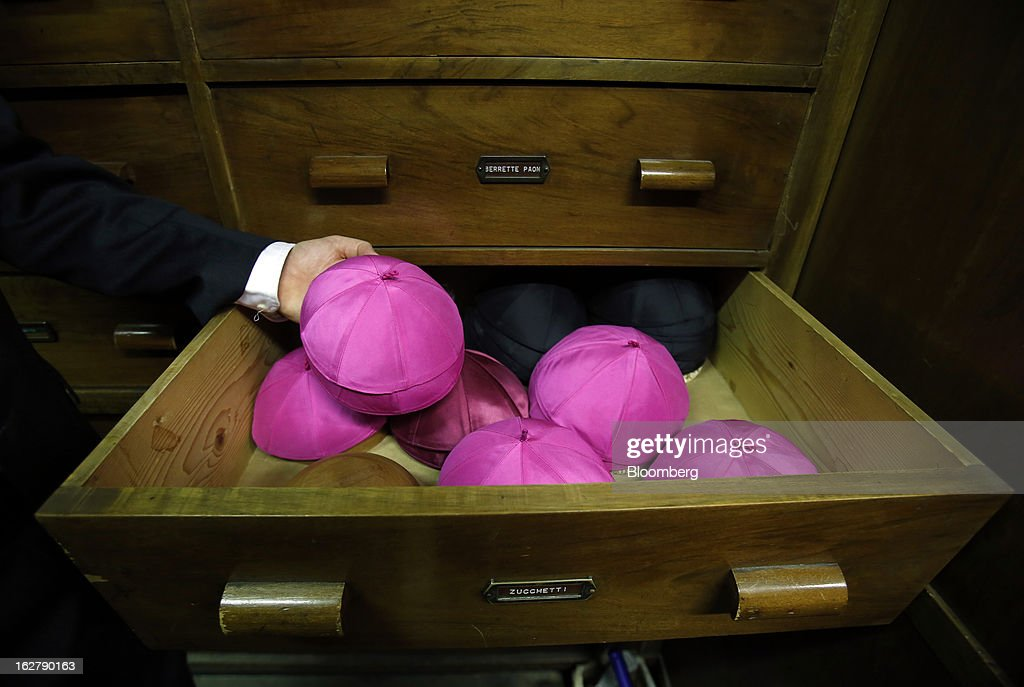 Stefano Gammarelli, an ecclesiastical tailor at Gammarelli, displays a clerical zucchetto, or skull cap, inside his family's store in Rome, Italy, on Friday, Feb. 22, 2013. Gammarelli was founded in 1797 under Pope Pius VI as tailors to the clergy, and lists other papal customers as John Paul I, Paul VI, and John XXIII. Photographer: Alessia Pierdomenico/Bloomberg via Getty Images