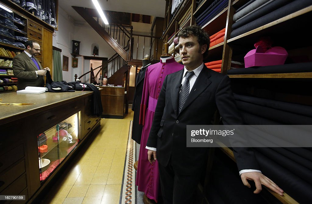 Stefano Gammarelli, an ecclesiastical tailor at Gammarelli, right, speaks during a Bloomberg Television interview inside his family's store in Rome, Italy, on Friday, Feb. 22, 2013. Gammarelli was founded in 1797 under Pope Pius VI as tailors to the clergy, and lists other papal customers as John Paul I, Paul VI, and John XXIII. Photographer: Alessia Pierdomenico/Bloomberg via Getty Images