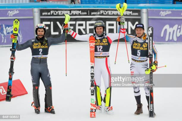 Stefano Gross of Italy takes 2nd place Michael Matt of Austria takes 1st place Felix Neureuther of Germany takes 3rd place during the Audi FIS Alpine...