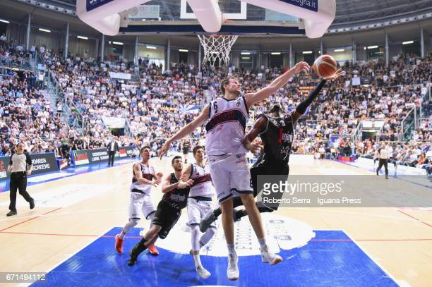 Stefano Mancinelli and Leonardo Candi and Michele Ruzzier of Kontatto competes with Michael Umeh and Marco Spissu of Segafredo during the LegaBasket...