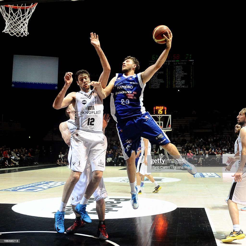 Stefano mancinelli of Lenovo competes with Jakub Parzenski of Oknoplast during the LegaBasket A1 basketball match between Oknoplast Bologna and Lenovo Cantu at Unipol Arena on May 5, 2013 in Bologna, Italy.