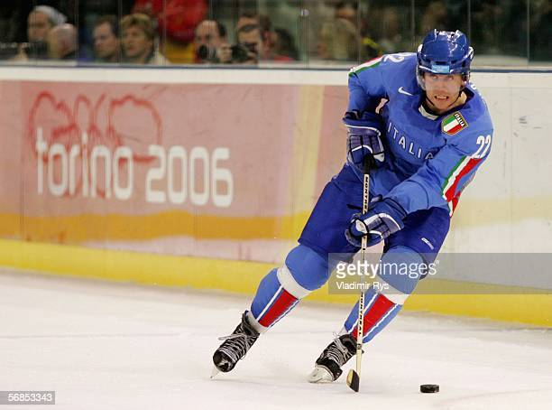 Stefano Margonni of Italy brings the puck down the ice during the men's ice hockey Preliminary Round Group A match against Canada on Day 5 of the...