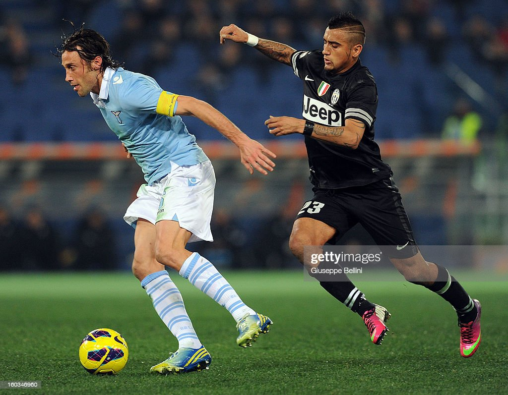 <a gi-track='captionPersonalityLinkClicked' href=/galleries/search?phrase=Stefano+Mauri&family=editorial&specificpeople=676361 ng-click='$event.stopPropagation()'>Stefano Mauri</a> of Lazio and <a gi-track='captionPersonalityLinkClicked' href=/galleries/search?phrase=Arturo+Vidal&family=editorial&specificpeople=2223374 ng-click='$event.stopPropagation()'>Arturo Vidal</a> of Juventus in action during the TIM cup match between S.S. Lazio and Juventus FC at Stadio Olimpico on January 29, 2013 in Rome, Italy.