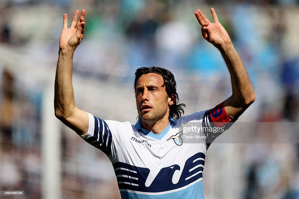 <a gi-track='captionPersonalityLinkClicked' href=/galleries/search?phrase=Stefano+Mauri&family=editorial&specificpeople=676361 ng-click='$event.stopPropagation()'>Stefano Mauri</a> of SS Lazio celebrates after scoring the opening goal during the Serie A match between SS Lazio and Empoli FC at Stadio Olimpico on April 12, 2015 in Rome, Italy.