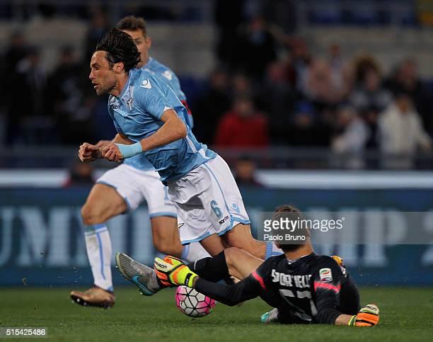 Stefano Mauri of SS Lazio is fauled by Atalanta BC goalkeeper Marco Sportiello during the Serie A match between SS Lazio and Atalanta BC at Stadio...