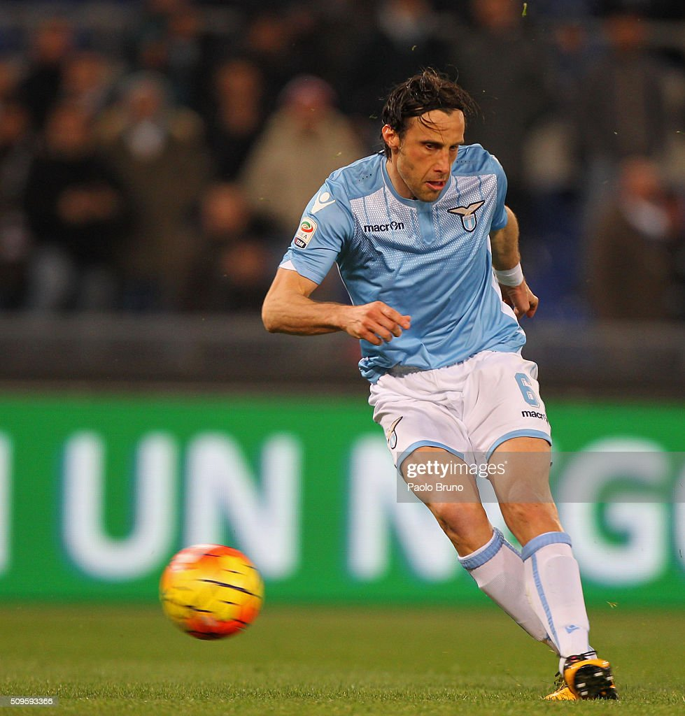 <a gi-track='captionPersonalityLinkClicked' href=/galleries/search?phrase=Stefano+Mauri&family=editorial&specificpeople=676361 ng-click='$event.stopPropagation()'>Stefano Mauri</a> of SS Lazio scores the team's second goal during the Serie A match between SS Lazio and Hellas Verona FC at Stadio Olimpico on February 11, 2016 in Rome, Italy.