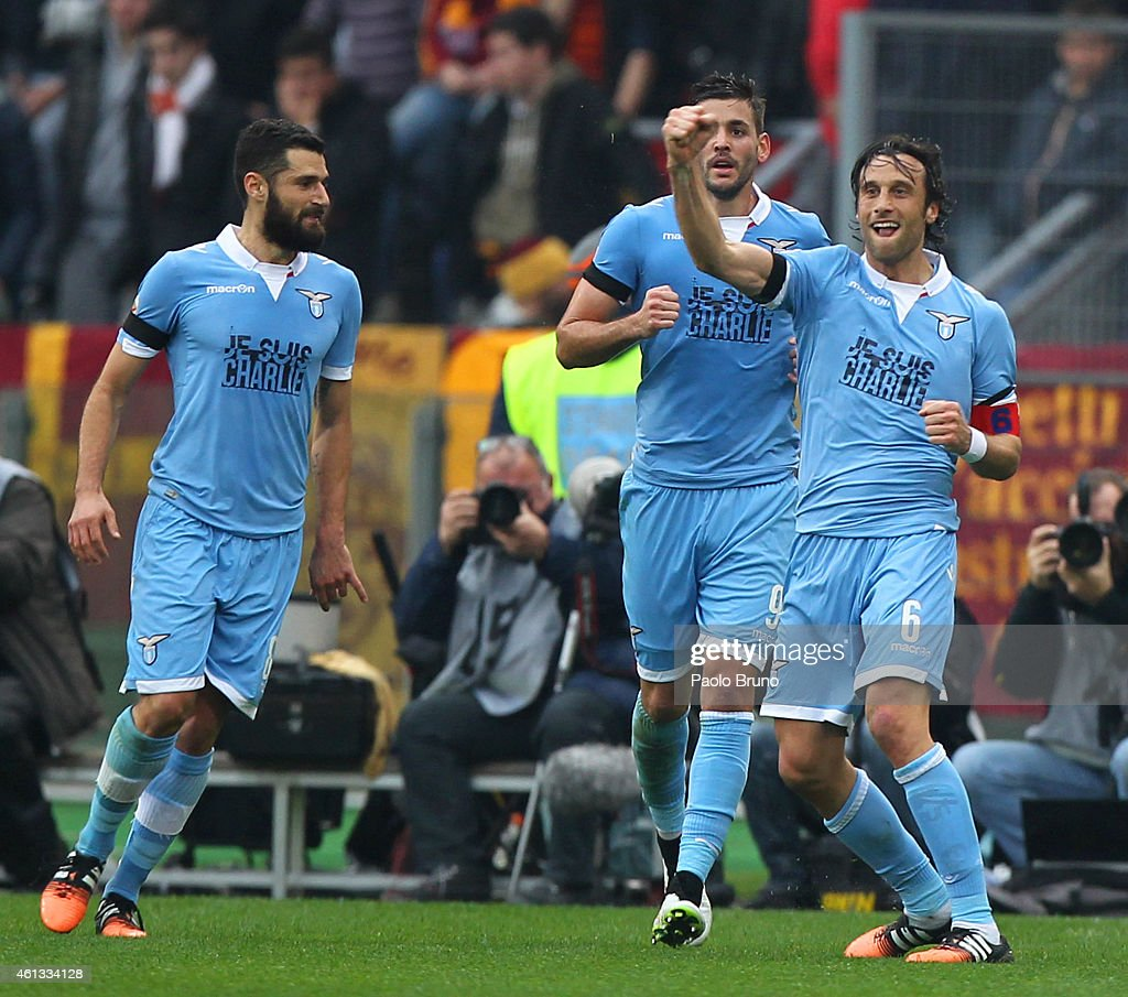 Stefano Mauri (R) with his teammates of SS Lazio celebrates after scoring the opening goal during the Serie A match between AS Roma and SS Lazio at Stadio Olimpico on January 11, 2015 in Rome, Italy.