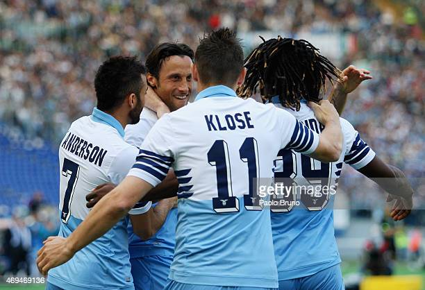 Stefano Mauri with his teammates of SS Lazio celebrates after scoring the opening goal during the Serie A match between SS Lazio and Empoli FC at...
