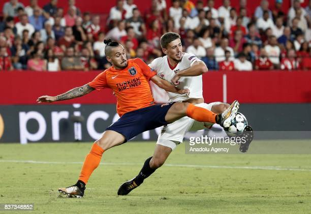 Stefano Napoleoni of Medipol Basaksehir in action against Clement Lenglet of Sevilla FC during a UEFA Champions League playoff match between Sevilla...