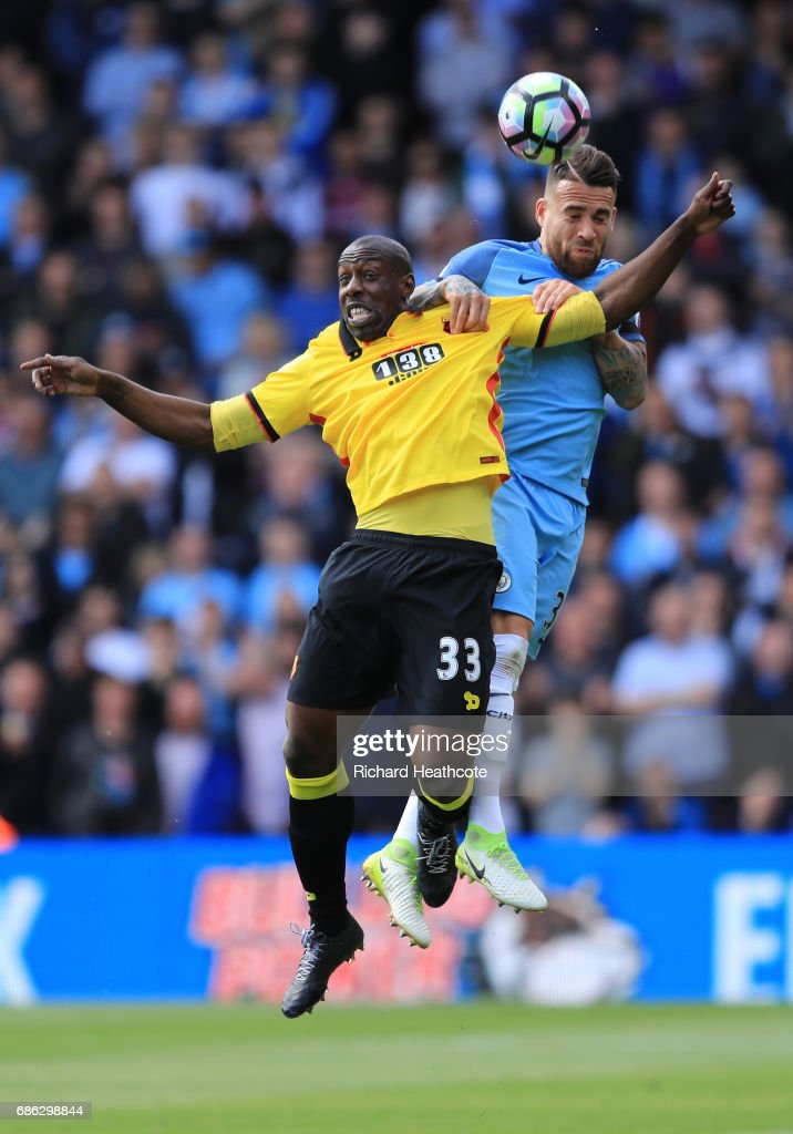 Stefano Okaka of Watford and Nicolas Otamendi of Manchester City clash during the Premier League match between Watford and Manchester City at Vicarage Road on May 21, 2017 in Watford, England.
