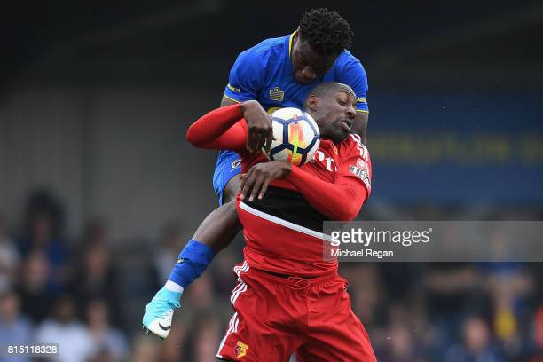 Stefano Okaka of Watford battles Deji Oshilaja of Wimbledon during the preseason friendly match between AFC Wimbledon and Watford at The Cherry Red...