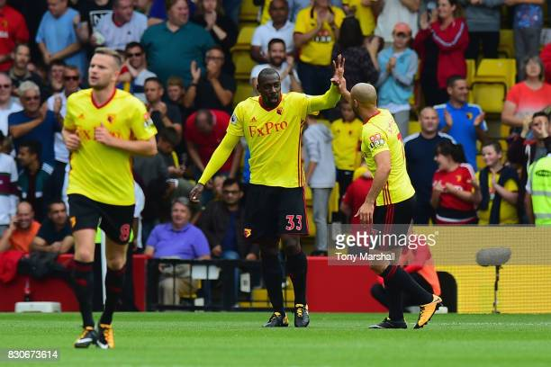 Stefano Okaka of Watford celebrates scoring his sides first goal with Nordin Amrabat of Watford during the Premier League match between Watford and...