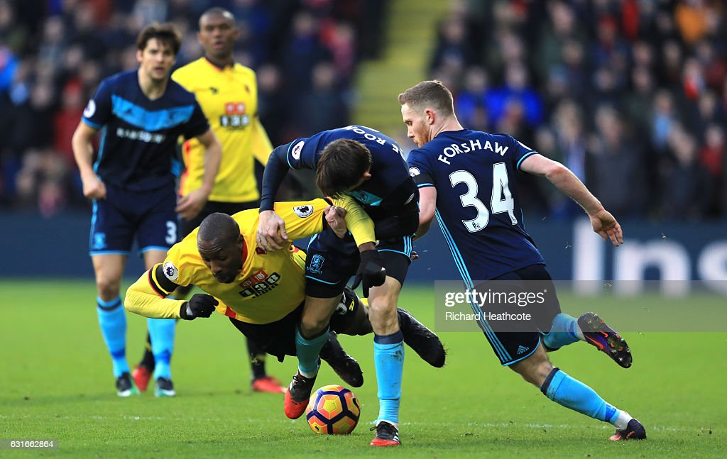 Stefano Okaka of Watford is fouled by Marten de Roon of Middlesbrough during the Premier League match between Watford and Middlesbrough at Vicarage Road on January 14, 2017 in Watford, England.