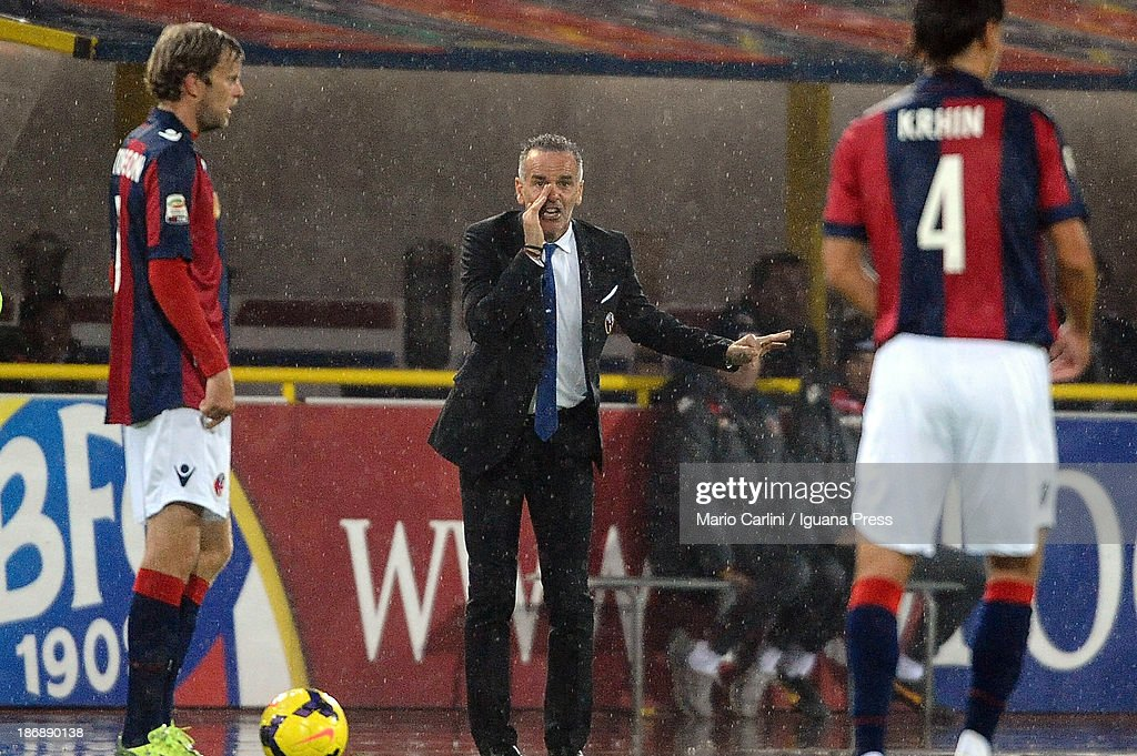 Stefano Pioli head coach of Bologna FC talks to his players by the sideline during the Serie A match between Bologna FC and AC Chievo Verona at Stadio Renato Dall'Ara on November 4, 2013 in Bologna, Italy.